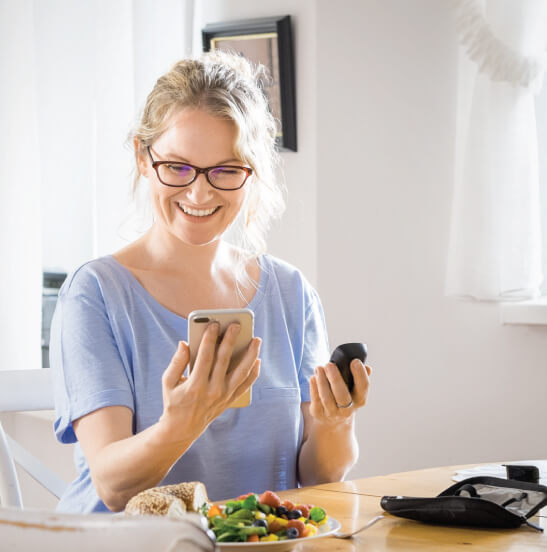 Woman using the mySugr app